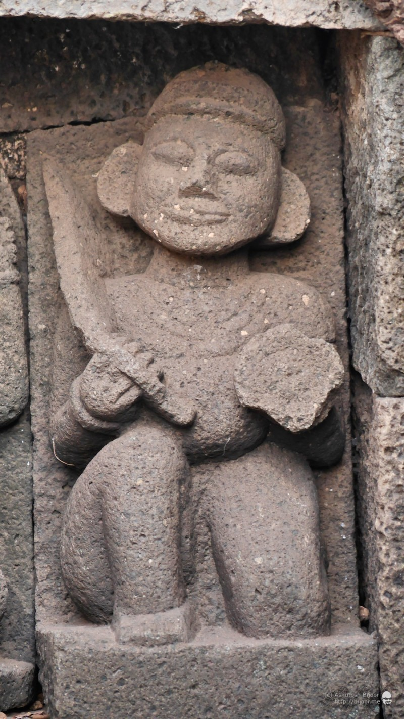 To the left of Lord Ganesha, the second figure with sword and shield seems like a warrior